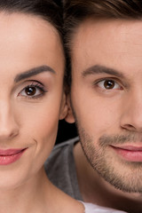 headshot of smiling woman and man looking to camera on black
