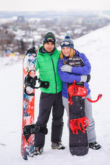 gay couple snowboarders posing for a photograph