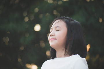 beautiful Asian girl with closed eyes