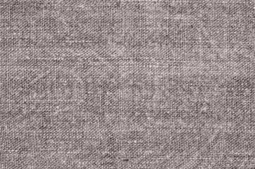 Homespun hemp cloth. Close-up of texture fabric cloth textile background. Homespun hemp fabric material. Homespun hemp canvas. Natural authentic cloth. Gray-green color