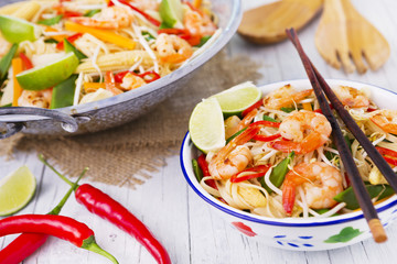 Healthy shrimp and vegetables stir-fry in a bowl, brightly lit