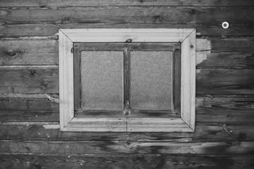 Window, wood wall, black-and-white photo.