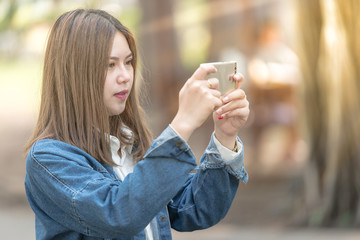 young woman using mobile phone for taking photo.