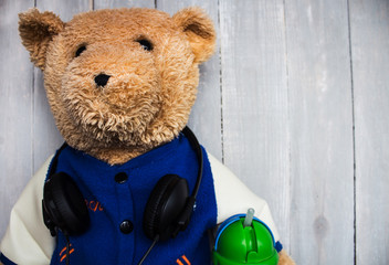 teddy bear with headphones on