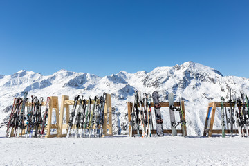 Skis on a rack outside a mountain restaurant in Obergurgl