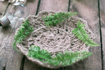 knitted cloth with plant leaves