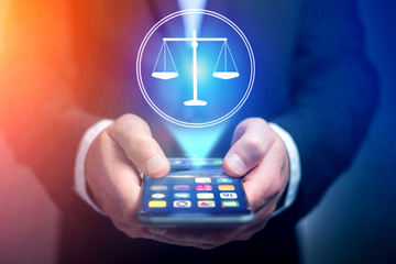 Businessman hand holding mobile phone with justice icon