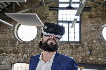Businessman wearing VR glasses