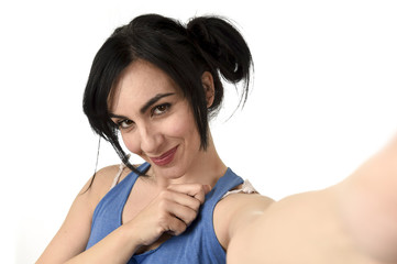 sexy woman taking selfie photo with stick and mobile phone camera posing happy
