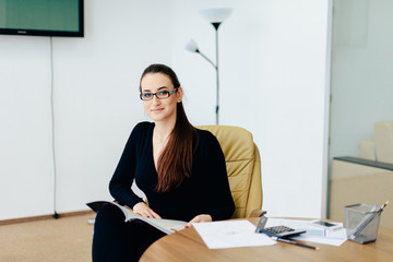 girl in a black dress and sunglasses in the office