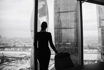 silhouette of a girl on the background of skyscrapers