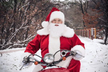 Santa Claus riding on scooter