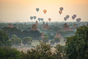 Hot air balloon over ancient pagoda in Bagan, Myanmar