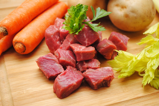 Fresh Beef Stew Ingredients on a Wooden Cutting Board
