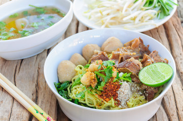 Thai - Chinese style spicy noodle with steamed pork and pork ball served with fresh vegetable and soup