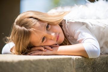 child winged angel fashion outdoors
