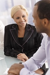 Happy businesswoman chatting with businessman