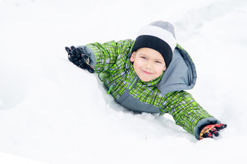 boy six crawling on the snowy mountains, and pulls his Hands Up