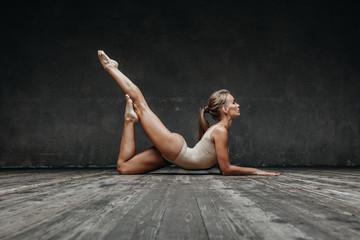 Young beautiful yoga posing in studio
