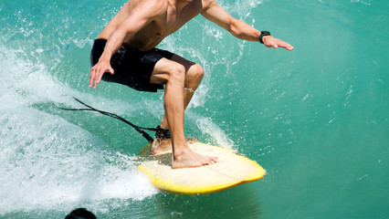 Surfing in tropical water
