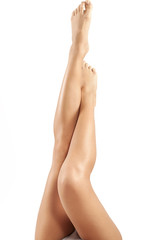 Perfect female legs. Isolated on white.