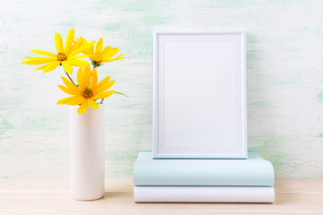 White frame mockup with golden yellow rosinweed and books