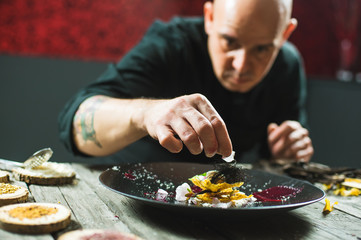 Chef is concentrated on preparing molecular dish