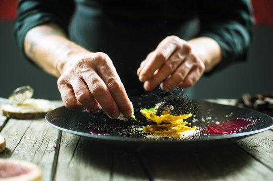 Close-up of male hands preparing molecular dish