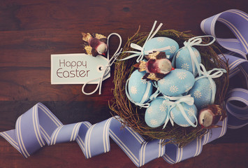 Easter birds nest with blue eggs.