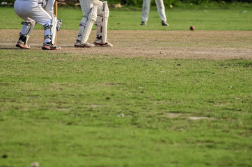 Cricket game was playing in field at Kolkata by boy.