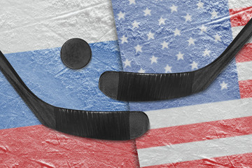 e American and Russian flags, two hockey sticks hockey