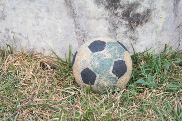 old football black and white on grass