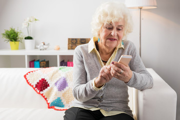 Grandmother using mobile phone