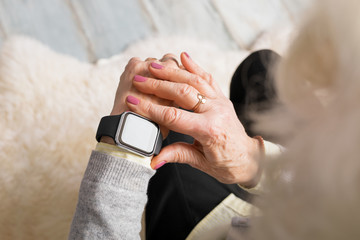Old person using smart watch