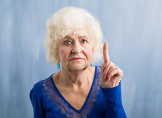 Grandma holding her finger up