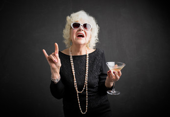 Cool grandmother with sunglasses and drink in hand Wall mural