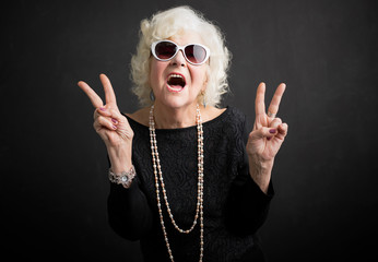 Cool grandmother showing peace sign