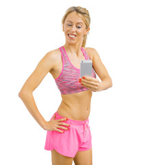 Fit woman taking a picture of her progress