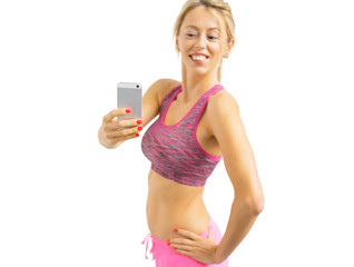 Fit woman taking mirror selfies