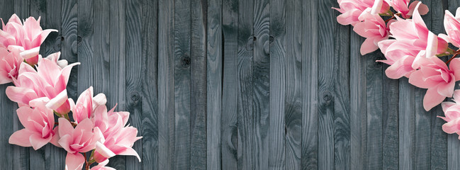 Wall Murals Magnolia Background with magnolia flowers on wall of wooden planks