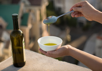 Olive oil over an Italian city background