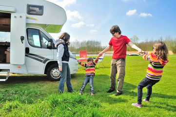 Family vacation, RV (camper) travel with kids, happy parents with children have fun on holiday trip in motorhome