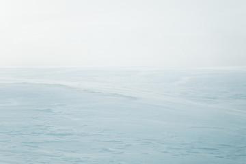 A beautiful, minimalist landscape of flat, snowy Norwegian field. Clean, light, high key, decorative look.