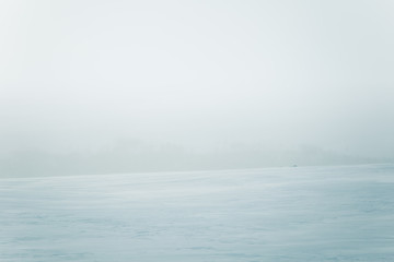 A beautiful, minimalist landscape of flat, snowy Norwegian field. Clean, light, high key, decorative look.