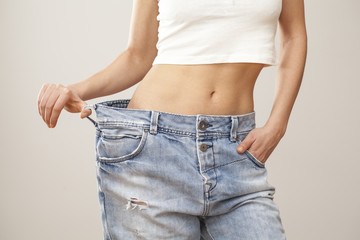 Weight loss woman with bluejeans