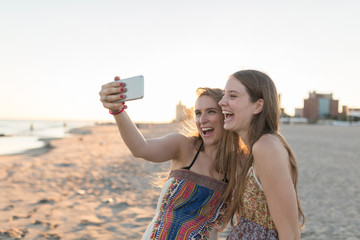Best Friends Taking a Picture with a Mobile Phone. Coney Island New York City US