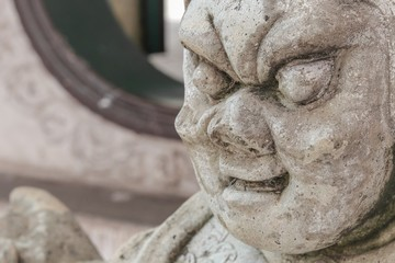 stone statue antique style China Closeup temple in Thailand.