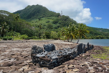 French Polynesia marae old stone structure on the shore of the lake Fauna Nui, Maeva, Huahine Nui island