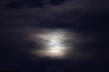 Full moon beautiful over dark black sky at have raincloud in night