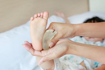 Mother compare baby foot with foot forming by resin at newborn.